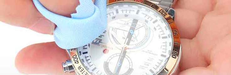 Cleaning the glass display of your luxury watch with a soft cloth and glass cleaner is an important finishing touch.