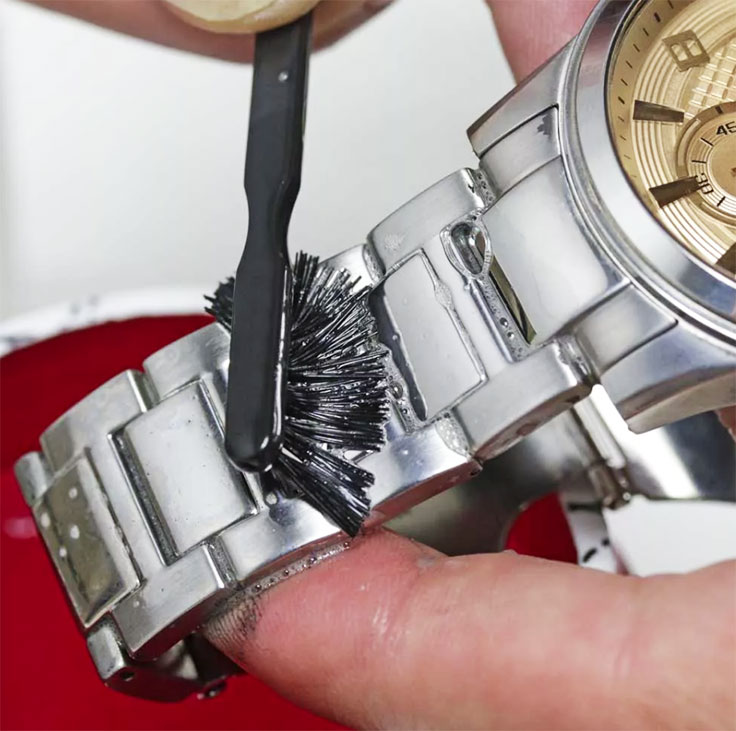 A soft-bristled toothbrush can be very useful when cleaning between the links of the watch's bracelet.